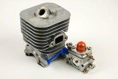 Motor och carburator i gräsklippare royaltyfri fotografi