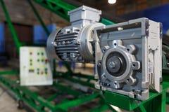 Motor och förminskningskugghjul Arkivbild