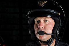 Motor officer. A police motorcycle officer in the night Royalty Free Stock Photos