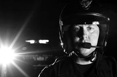 Motor officer. A police motorcycle officer in the night Royalty Free Stock Photography