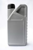 Motor oil bottle. Gray bottle on a white background Stock Images