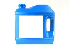 Motor oil bottle. A blue motor oil bottleisolated on white background Royalty Free Stock Images