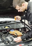 Motor Oil Checking Royalty Free Stock Photography