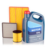 Motor oil filters and plastic canister Royalty Free Stock Image