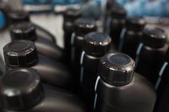 Motor oil in plastic bottle. Store showcases Royalty Free Stock Image