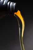 Motor oil pouring Stock Photo