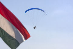Motor paraglider with dark blue sky and Hungary flag Royalty Free Stock Photography