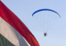 Motor paraglider with dark blue sky and Hungary flag Stock Photo