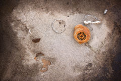 Motor parts on the sand. Details of the rusty engine scattered on the sand Royalty Free Stock Image