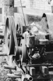 Motor of a pile driver. Bate-estaca used to dig the soil and make the foundation to support the building. Strauss piledriver driven by a motor. Black and white royalty free stock photography