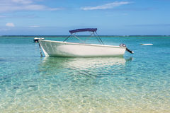 Motor recreation boats on the tropical beach. Blue water and Motor recreation boats on the tropical beach in the island of Mauritius Stock Image