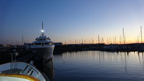 Motor an sailing yachts in marina during the sunset Stock Images