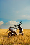 Motor Scooter in Field of Wheat Royalty Free Stock Photo