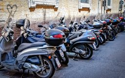 Motor scooters parking. On a small street in Rome Royalty Free Stock Photography