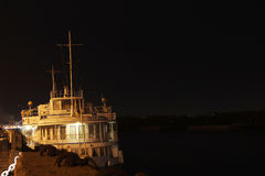 Motor ship standing on the dock. Motor ship standing on the river at night Royalty Free Stock Images