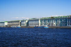 Motor ships parked near The Winter Palace, St. Petersburg, Russi Stock Photos