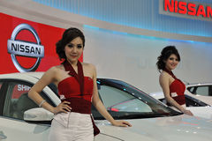 Motor Show in Bangkok. A view from the Nissan booth as models present the Nissan vehicles at the Thailand International Motor Expo on Dececmber 7, 2012 in Royalty Free Stock Photo