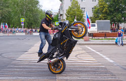 Motor Show from the team CK Stunt - show of Russian riders on the opening of the exhibition of young people in the city of Novokui. Brave guys to conquer the Stock Photography