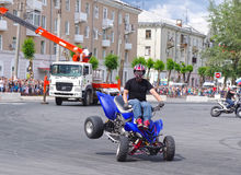 Motor Show from the team CK Stunt - show of Russian riders on the opening of the exhibition of young people in the city of Novokui. Brave guys to conquer the Royalty Free Stock Photo