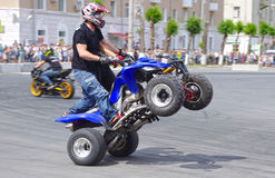 Motor Show from the team CK Stunt - show of Russian riders on the opening of the exhibition of young people in the city of Novokui. Brave guys to conquer the Stock Photos