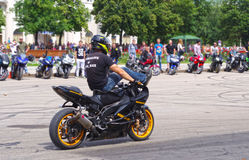 Motor Show from the team CK Stunt - show of Russian riders on the opening of the exhibition of young people in the city of Novokui. Brave guys to conquer the Stock Image