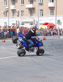 Motor Show from the team CK Stunt - show of Russian riders on the opening of the exhibition of young people in the city of Novokui. Brave guys to conquer the Royalty Free Stock Image