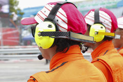 Motor sport rescue team with headphones Royalty Free Stock Images