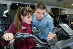 In motor sports dealership Stock Photography