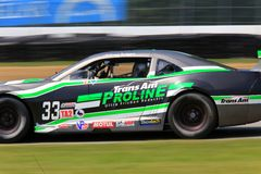 Motor Sports racing. Scott Ferguson races the Chevrolet Camaro for the Make A Wish Racing at the professional motorsports racing event, International Motor Royalty Free Stock Photos