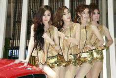 Motor Stunning Supermodels. 4 Stunning supermodels posts charmingly under Golden Suit ahead Red Bentley at Challenger Hall, Impact Arena Muang Thong Thani in Stock Images
