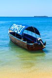 Motor tourist boat lying near the beach Stock Photos