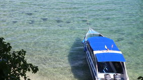 Motor tourist speed boat tied up at sea coast stock video footage