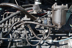 Motor tractor closeup. Motor tractors, agricultural motor vehicle parts, part of the diesel engine, the engine of the tractor close-up, the engine of the vehicle Stock Photos