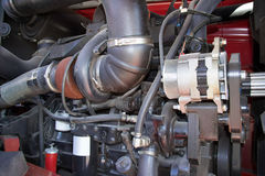 Motor tractor closeup. Motor tractors, agricultural motor vehicle parts, part of the diesel engine, the engine of the tractor close-up, the engine of the vehicle Royalty Free Stock Image