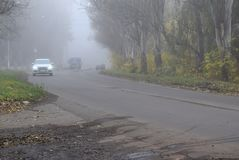 Motor transport moves in conditions of thick fog. stock images