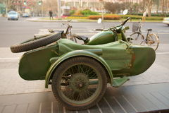 Motor tricycle. On the street.It looks very old Royalty Free Stock Photo