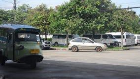 Motor tricycle or tuk tuk thai style at Bus terminal. TRANG, THAILAND - JULY 12 : Motor tricycle or tuk tuk thai style at Bus terminal on July 12, 2016 in Trang stock video