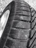 Motor Tyre Repair. Close up black and white image of a motor vehicle tyre repair Royalty Free Stock Photo
