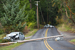 Motor Vehicle Accident. Scene of a motor vehicle accident into a power line with police blocking roadway Stock Photo