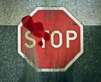 Motor vehicle accident, skid marks, blood, injury, death, high speed, stop sign Stock Images