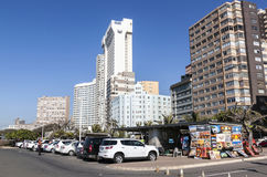 Motor Vehicles Parked Next to Street Vendor City Skyline Royalty Free Stock Image