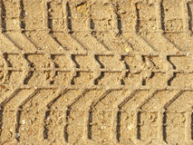 Motor vehicles traces on the sand. Stock Photos