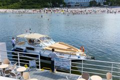The motor yacht arriving to the pier Stock Images