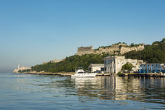 Motor yacht below Fortress of San Carlos de la Cabaña Havana Royalty Free Stock Photo