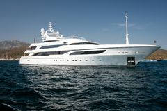 Motor yacht in the blue sea. Large luxury motor yacht in the blue sea royalty free stock photos