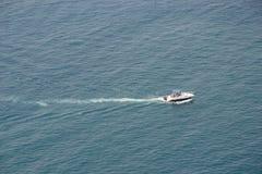 Motor yacht in blue seas Stock Photo
