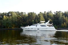 Motor yacht `Nadezhda` on the Moscow River in Serebryany Bor. MOSCOW, RUSSIA - SEPTEMBER 24, 2015: Motor yacht `Nadezhda` on the Moscow River in Serebryany Bor Royalty Free Stock Photo