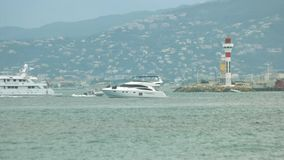 Motor yacht near lighthouse. stock footage