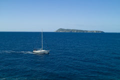 Motor yacht passing by the island Stock Photo