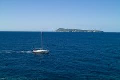 Motor yacht passing by the island. Bisevo near Vis in Croatia stock photo